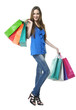 Full length portrait of happy young woman carrying shopping bags