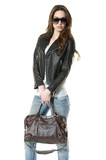 picture of Stylish woman in blue jeans holding handbag