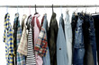 multicolored casual men's clothes shirts on hangers,