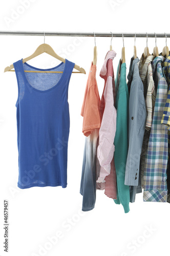 casual shirts on wooden hangers, isolated on white.