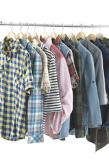 casual men's clothes shirts on hangers,