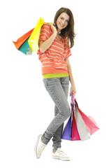 Full length shopping girl posing