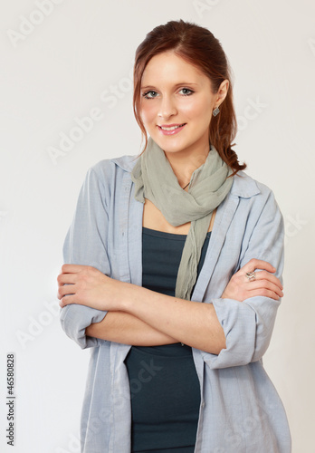 A young woman standing with folded arms