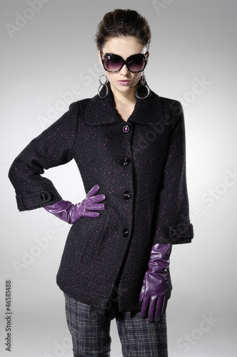 fashion model in sunglassesposing girl on light background