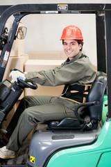 Portrait Of A Confident Forklift Driver