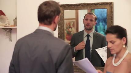 Businessman preparing speech in front of the mirror