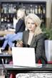 Woman on laptop in wine bar