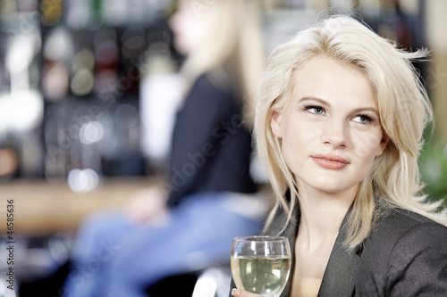 Woman relaxing in wine bar