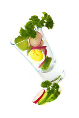 slices of vegetables served in a glass on a white background