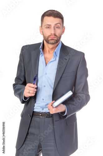 Portrait of thoughtful business man with diary