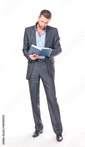 Full length portrait of thoughtful business man with diary