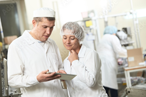 Two pharmacy industry workers with tablet pc