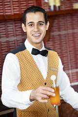 Cheerful arab barman