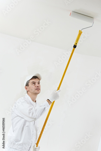 house painter at work with painting roller