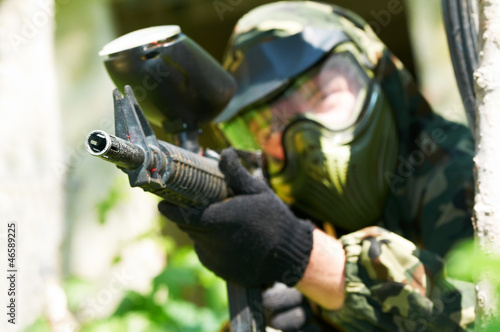 paintball player in summer. Shallow DOF