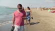 Man with smartphone walking on the beach, steadicam shot