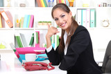 Young pretty business woman with phone and notebook working at