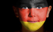 Portrait of a child with a painted German flag
