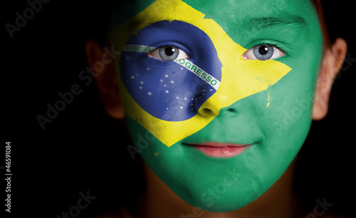 Portrait of a child with a painted flag