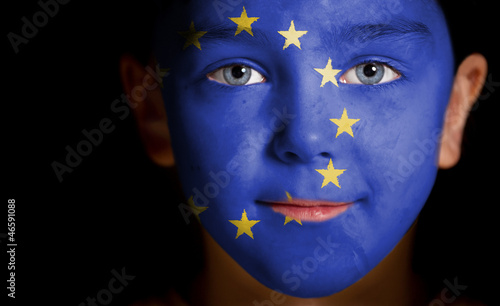 Portrait of a child with a painted EU flag