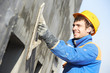 facade builder plasterer at work - 46591217