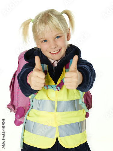 Cute child with reflective vest showing thumbs up