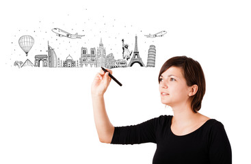 Young woman drawing famous cities and landmarks on whiteboard