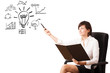 Young business woman presenting light bulb with various diagrams