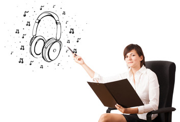 Young girl presenting headphone and musical notes