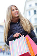 Young blond woman shopper