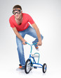 Man on a children's bicycle