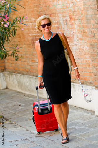 Touring Venice - woman on the way to the hotel