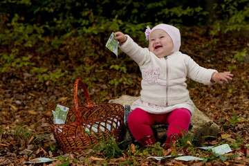 little girl with a basket of euro