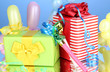 Colorful gift boxes on blue background