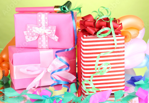 Colorful gift boxes on green background