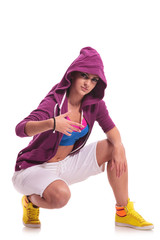 street dancer posing in crouched position