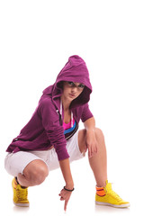 hip hop woman crouched, touching the floor