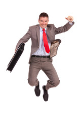 business man holding briefcase and jumping