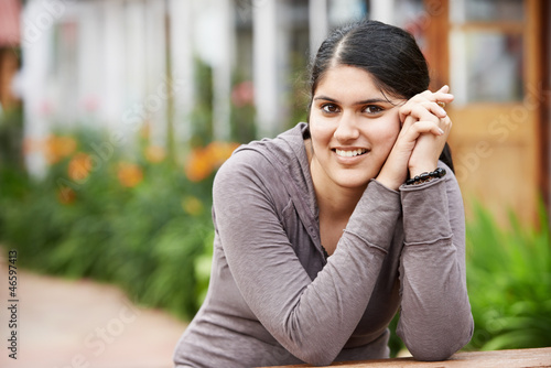 Happy indian young girl student