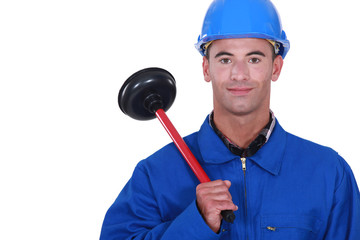 craftsman holding a plunger