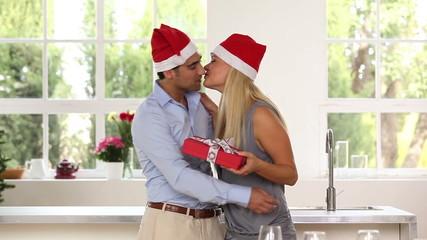 Husband giving wife a christmas present