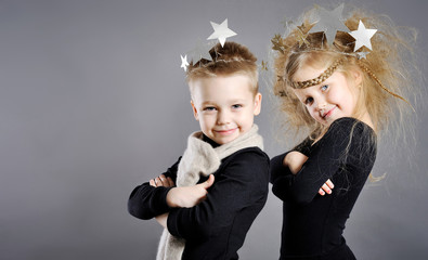 portrait of little boys and girls in the studio in a Christmas s
