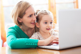 Daughter and mother looking at a laptop