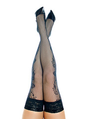 Female legs in black stockings raised up and crosed.