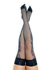 Female legs in black stockings raised up and crosed.