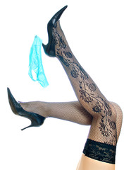 Sexy female legs raised up with blue panties on a heel.