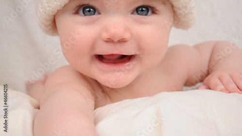 Cute Little Happy Baby with White Hat