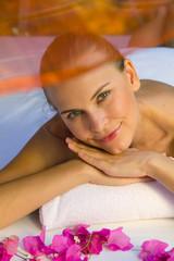 Happy smiling female enjoys in spa.