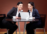 Two 20s business women with laptop and coffee 1 poster