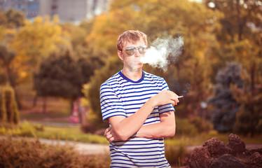 Man smoking a cigarette outside